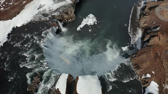 Thumbnail for Aerial View of Godafoss Waterfall with Snowy Shore and Ice. Iceland. Winter 2019