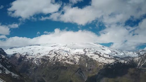Aerial View Timelapse of the Elbrus Mountain Behind the Flowing Clouds
