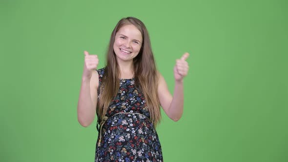 Thumbnail for Young Happy Pregnant Woman Giving Thumbs Up and Looking Excited
