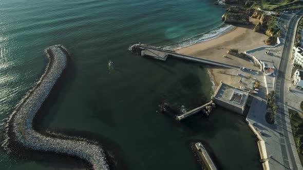 Thumbnail for Tiny Boat Entering Ocean Through Harbour Gates