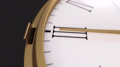 Closeup of Golden Watch Minute Arrow Camera Follows As It Move All the Way Around a Clock