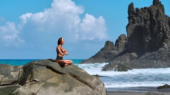 Cover Image for Serene Meditation Yoga. Brunette Tourist Woman Meditating in Lotus Position