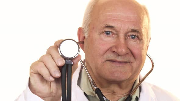 Thumbnail for Senior Male Doctor Holding Up a Stethoscope To the Camera