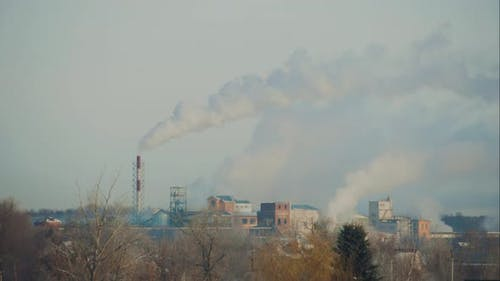 High Pollution the Atmosphere with Smoke and Smog From Chemical Factory with Smoke Stack. Global