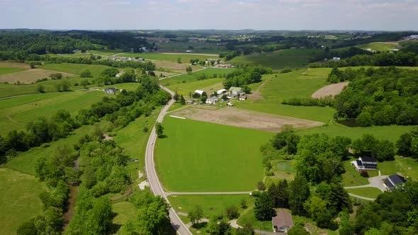 Aerial of green fields in a rural region