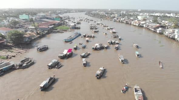 Thumbnail for Aerial: rotating panorama over Cai Rang floating market Can Tho Vietnam