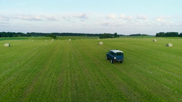 Thumbnail for Jeep Driving Through Green Field