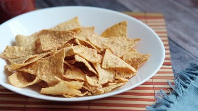 a Bowl of Chips and Salsa on Table