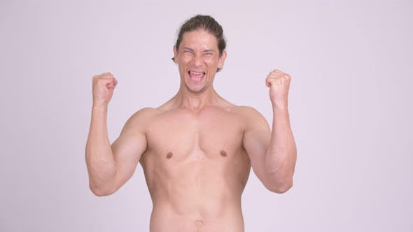 Thumbnail for Happy Muscular Shirtless Man Looking Excited with Fists Raised