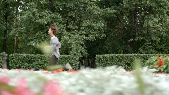 Thumbnail for Woman Running in Park