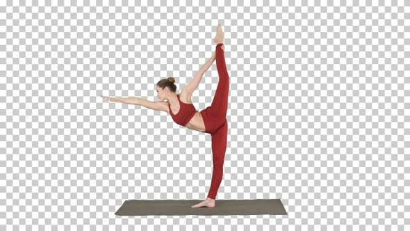 Cover Image for Slim woman standing in yoga pose dandayamana dhanurasana