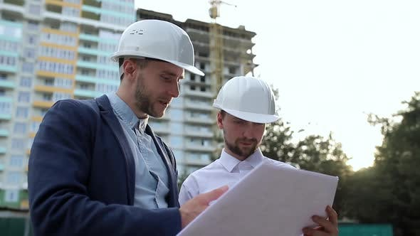 Thumbnail for Construction engineers look at building plans