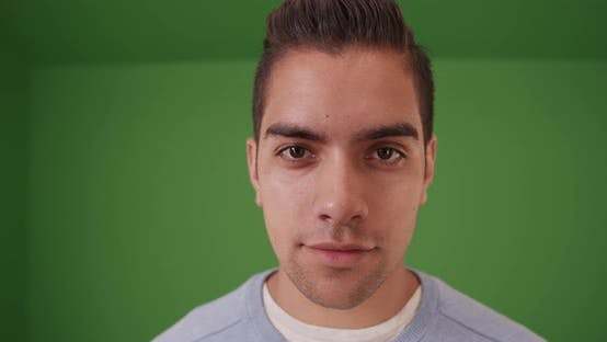 Thumbnail for Wide angle close up shot of Hispanic man on green screen