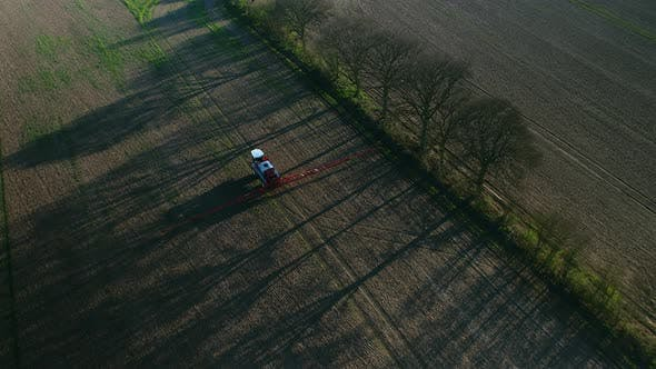Spraying Machine Working Fields on an Arable Farm with Glyphosate Herbicide