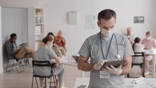 Man in Scrubs Posing in Clinic