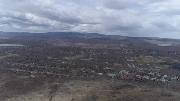 Panorama of Karabash city. Chelyabinsk region, Russia. Aerial, spring, cloudy