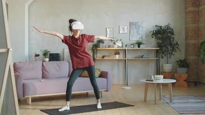 Woman in VR Headset Training at Home