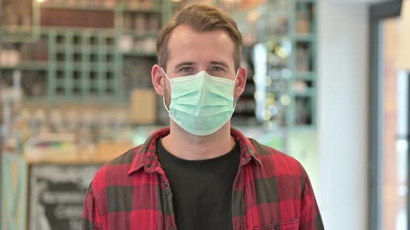Thumbnail for Portrait of Young Man with Protective Face Mask