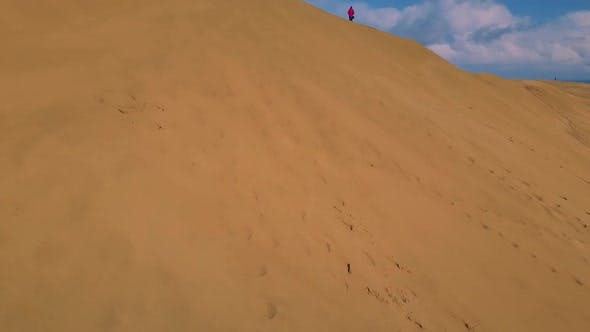 Thumbnail for Man on sand dunes by the sea