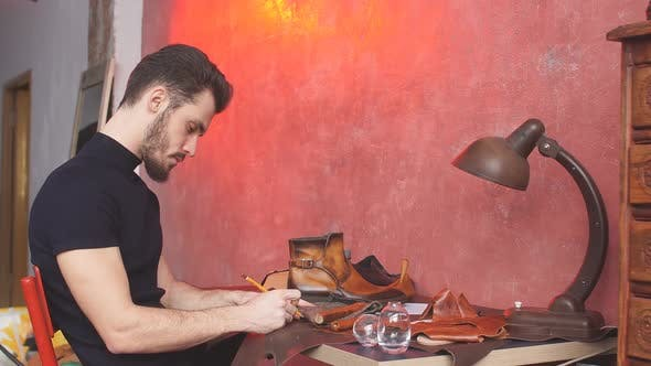 Serious Cobbler Engaging in Shoe Making Process