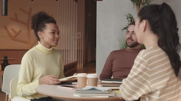 Diverse Friends Chatting in Restaurant