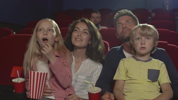 Thumbnail for Family Enjoying Interesting Film in the Cinema