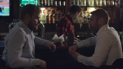 Businessmen Talking at Bar Counter