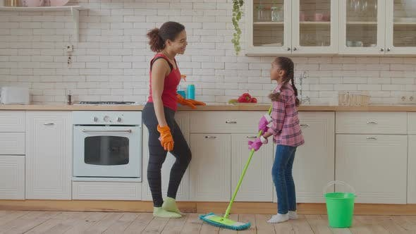 Thumbnail for Little Girl Washing Floor with Mop in Kitchen