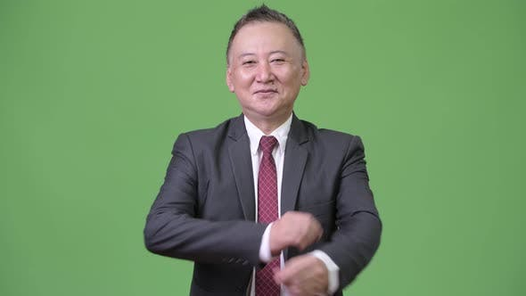 Thumbnail for Mature Happy Japanese Businessman Smiling with Arms Crossed