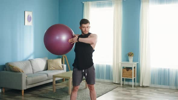 Thumbnail for Athletic Man Is Doing Upper Body Rotation Exercise