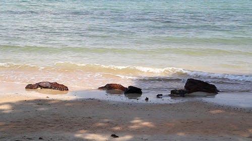 Beach Rocks And Waves