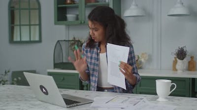Millennial African American Female Freelancer Having Online Conference Working at Home