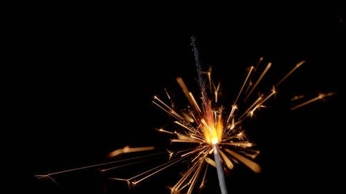 Bengal Fire New Year Sparkler Candle Sparkling Lights Burning on a Black Background Slow Motion