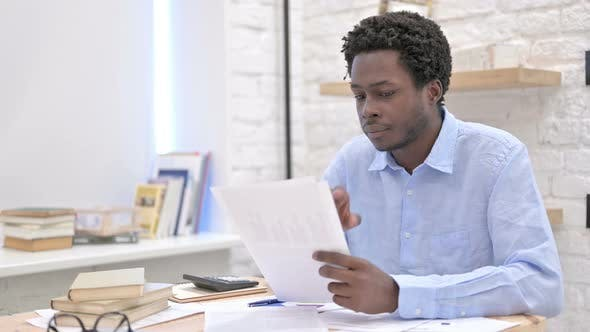 Thumbnail for African Man Reading The Documents