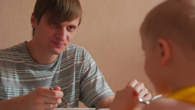 Man Eating Lunch With Boy