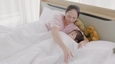 Mother and daughter are sleeping on the bed 4