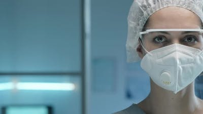 Portrait of Female Lab Scientist in Face Mask