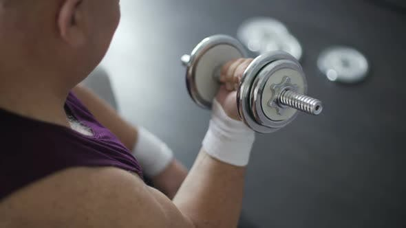 Thumbnail for Corpulent person trying to lift dumbbells, workout for weight loss, laziness