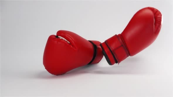Thumbnail for Pair of Red Leather Boxing Gloves Falling and Bouncing Isolated on White