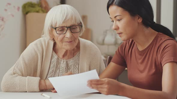 Thumbnail for Female Social Worker Explaining Documents to Old Woman
