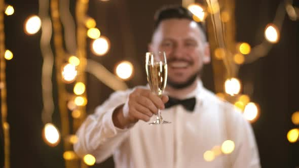 Cover Image for Portrait of Happy Man Raising Glass of Champagne