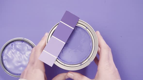 Thumbnail for Close up of metal paint can with purple paint and paint swatch.