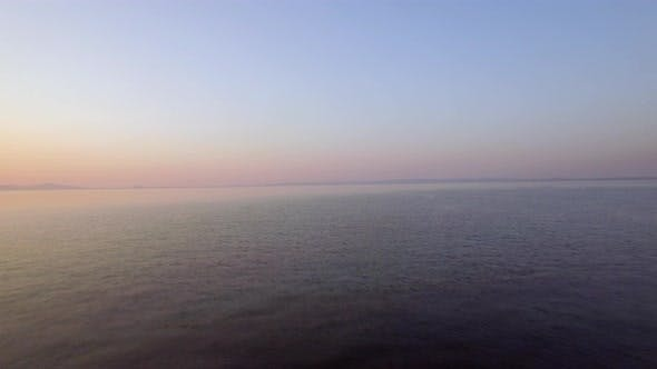 Thumbnail for Aerial Evening View of Vast Sea, Lonely Boat and Skyline