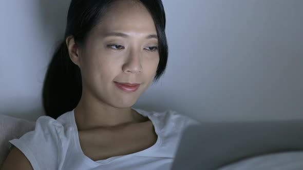 Cover Image for Woman use of laptop computer on bed