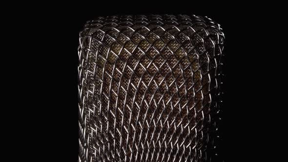 Cover Image for Studio Condenser Microphone Rotates on Black Background