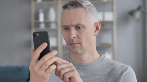 Gray Hair Man in Shock While Using Smartphone, Tragedy
