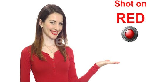 Attractive Woman In Red Clothes Showing Copy Space For Your Text Or Product With A Hand Isolated