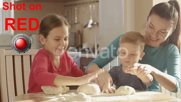 Cover Image for Happy Family Cooking Together In The Kitchen Playing With The Dough And Ingredients shot on RED