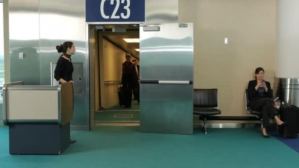 Thumbnail for Airport passengers walk out of jet way door