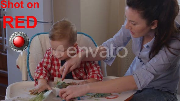 Thumbnail for Beautiful Mother Developing Creativity With Child Drawing Finger Paints Happy family shot on RED